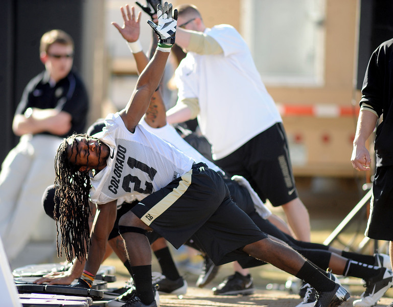 "DD Goodson, stretches during the first CU Spring practice on Thursday.<br /> For more photos of practice, go to  <a href=""http://www.dailycamera.com"">http://www.dailycamera.com</a>.<br /> Cliff Grassmick  / March 6, 2013"
