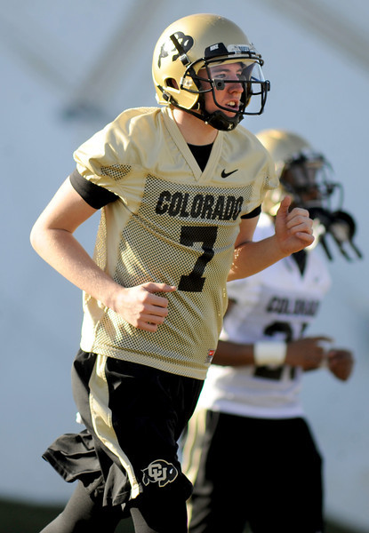 "CU quarterback, Shane Dillon, at the first Spring football practice on Thursday.<br /> For more photos of practice, go to  <a href=""http://www.dailycamera.com"">http://www.dailycamera.com</a>.<br /> Cliff Grassmick  / March 6, 2013"