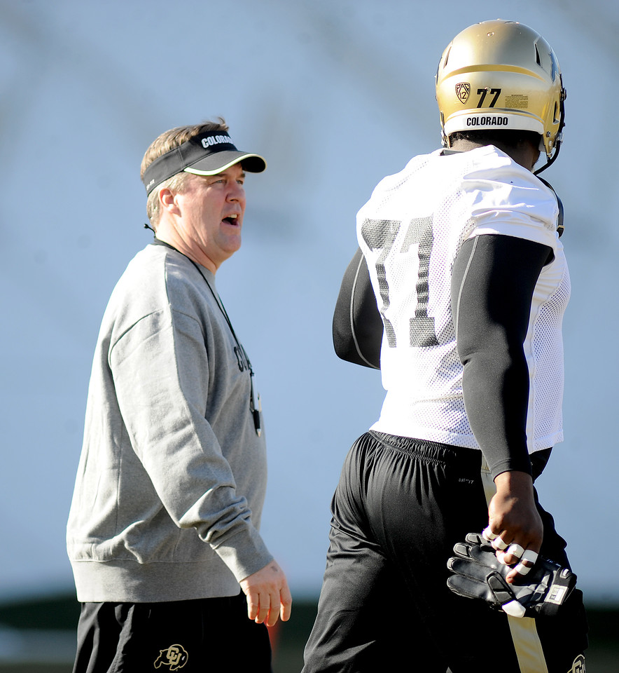 "New University of Colorado football coach, Mike MacIntyre, talks with Stephane Nembot during  the first Spring practice on Thursday.<br /> For more photos of practice, go to  <a href=""http://www.dailycamera.com"">http://www.dailycamera.com</a>.<br /> Cliff Grassmick  / March 6, 2013"