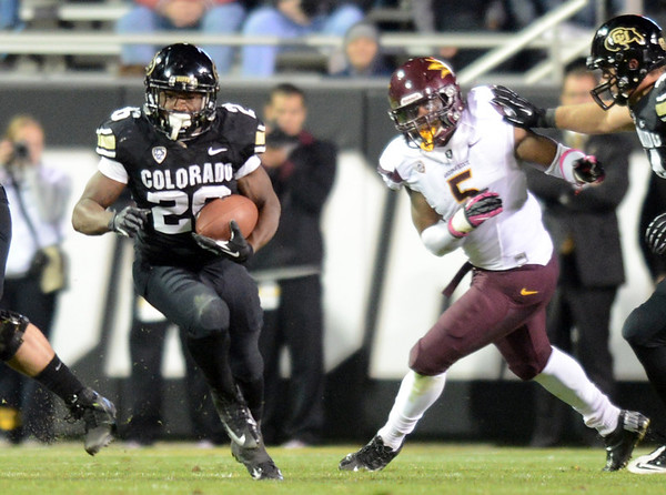 "Tony Jones of CU gets yards against ASU.<br /> For more photos of the game, go to  <a href=""http://www.dailycamera.com"">http://www.dailycamera.com</a><br /> Cliff Grassmick / October 11, 2012"