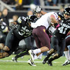 "Woodson Greer III , left and Terrel Smith of CU, tackle D.J.Foster of ASU.<br /> For more photos of the game, go to  <a href=""http://www.dailycamera.com"">http://www.dailycamera.com</a><br /> Cliff Grassmick / October 11, 2012"