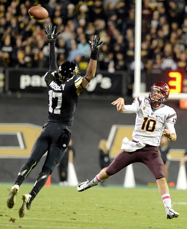 """University of Colorado's Marques Mosley tries to block a pass from Taylor Kelly during a game against Arizona State on Thursday, Oct. 11, at Folsom Field in Boulder. Fore more photos of the game go to  <a href=""""http://www.dailycamera.com"""">http://www.dailycamera.com</a><br /> Jeremy Papasso/ Camera"""