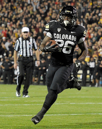 """University of Colorado's Tony Jones runs the ball in for a touchdown during a game against Arizona State on Thursday, Oct. 11, at Folsom Field in Boulder. Fore more photos of the game go to  <a href=""""http://www.dailycamera.com"""">http://www.dailycamera.com</a><br /> Jeremy Papasso/ Camera"""
