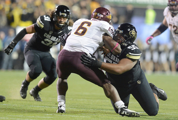"""University of Colorado's Gus Handler misses a tackle on Cameron Marshall during a game against Arizona State on Thursday, Oct. 11, at Folsom Field in Boulder. Fore more photos of the game go to  <a href=""""http://www.dailycamera.com"""">http://www.dailycamera.com</a><br /> Jeremy Papasso/ Camera"""