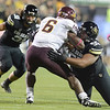 "University of Colorado's Gus Handler misses a tackle on Cameron Marshall during a game against Arizona State on Thursday, Oct. 11, at Folsom Field in Boulder. Fore more photos of the game go to  <a href=""http://www.dailycamera.com"">http://www.dailycamera.com</a><br /> Jeremy Papasso/ Camera"
