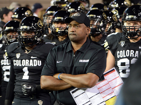 """Coach Jon Embree waits with the Buffs to run behind Ralphie.<br /> For more photos of the game, go to  <a href=""""http://www.dailycamera.com"""">http://www.dailycamera.com</a><br /> Cliff Grassmick / October 11, 2012"""