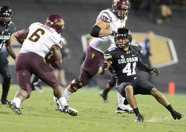 "University of Colorado's Terrel Smith gets jukes by Cameron Marshall during a game against Arizona State on Thursday, Oct. 11, at Folsom Field in Boulder. Fore more photos of the game go to  <a href=""http://www.dailycamera.com"">http://www.dailycamera.com</a><br /> Jeremy Papasso/ Camera"
