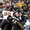 "Jordan Webb of CU, fires the ball against the ASU pass rush.<br /> For more photos of the game, go to  <a href=""http://www.dailycamera.com"">http://www.dailycamera.com</a><br /> Cliff Grassmick / October 11, 2012"