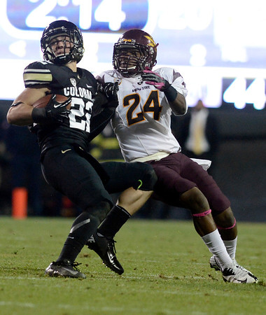 "University of Colorado's Nelson Spruce puts a spin move on Osahon Irabor after making a catch during a game against Arizona State on Thursday, Oct. 11, at Folsom Field in Boulder. Fore more photos of the game go to  <a href=""http://www.dailycamera.com"">http://www.dailycamera.com</a><br /> Jeremy Papasso/ Camera"