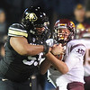 "Josh Tupou of CU gets a hold of ASU QB, Taylor Kelly after a run.<br /> For more photos of the game, go to  <a href=""http://www.dailycamera.com"">http://www.dailycamera.com</a><br /> Cliff Grassmick / October 11, 2012"