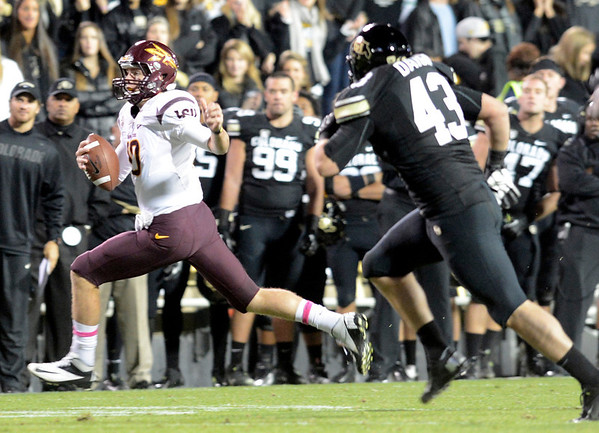 "University of Colorado's Brady Daigh chases down quarterback Taylor Kelly during a game against Arizona State on Thursday, Oct. 11, at Folsom Field in Boulder. Fore more photos of the game go to  <a href=""http://www.dailycamera.com"">http://www.dailycamera.com</a><br /> Jeremy Papasso/ Camera"