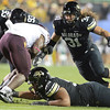 "University of Colorado's Jon Major, No. 31, comes in for the tackle on Cameron Marshall during a game against Arizona State on Thursday, Oct. 11, at Folsom Field in Boulder. Fore more photos of the game go to  <a href=""http://www.dailycamera.com"">http://www.dailycamera.com</a><br /> Jeremy Papasso/ Camera"