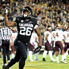 "Tony Jones of CU celebrates a first half touchdown with the crowd.<br /> For more photos of the game, go to  <a href=""http://www.dailycamera.com"">http://www.dailycamera.com</a><br /> Cliff Grassmick / October 11, 2012"