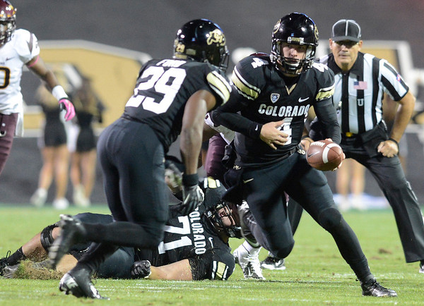 "University of Colorado quarterback Jordan Webb hands the ball off to Josh Ford  during a game against Arizona State on Thursday, Oct. 11, at Folsom Field in Boulder. Fore more photos of the game go to  <a href=""http://www.dailycamera.com"">http://www.dailycamera.com</a><br /> Jeremy Papasso/ Camera"