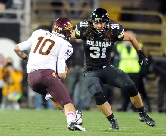 "Jon Major of CU, closes in on ASU QB, Taylor Kelly.<br /> For more photos of the game, go to  <a href=""http://www.dailycamera.com"">http://www.dailycamera.com</a><br /> Cliff Grassmick / October 11, 2012"
