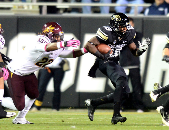 "Tony Jones of CU gets yards against  James Morrison of ASU.<br /> For more photos of the game, go to  <a href=""http://www.dailycamera.com"">http://www.dailycamera.com</a><br /> Cliff Grassmick / October 11, 2012"
