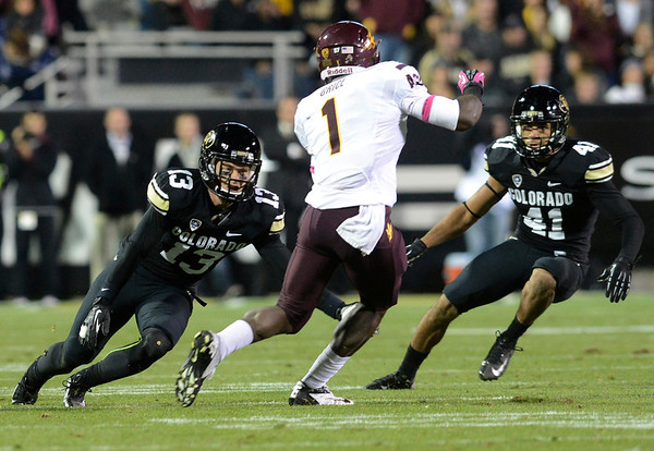 """University of Colorado's Parker Orms, left, and Terrel Smith work together to tackle Marion Grice during a game against Arizona State on Thursday, Oct. 11, at Folsom Field in Boulder. Fore more photos of the game go to  <a href=""""http://www.dailycamera.com"""">http://www.dailycamera.com</a><br /> Jeremy Papasso/ Camera"""