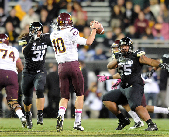 """Jon Major (31) and Josh Tupou, both of CU, pressure Taylor Kelly of ASU.<br /> For more photos of the game, go to  <a href=""""http://www.dailycamera.com"""">http://www.dailycamera.com</a><br /> Cliff Grassmick / October 11, 2012"""