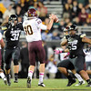 "Jon Major (31) and Josh Tupou, both of CU, pressure Taylor Kelly of ASU.<br /> For more photos of the game, go to  <a href=""http://www.dailycamera.com"">http://www.dailycamera.com</a><br /> Cliff Grassmick / October 11, 2012"