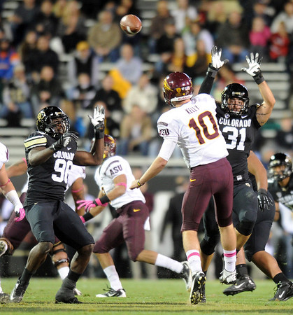 """Nate Bonsu, left, and Jon Major, both of CU, pressure Taylor Kelly of ASU.<br /> For more photos of the game, go to  <a href=""""http://www.dailycamera.com"""">http://www.dailycamera.com</a><br /> Cliff Grassmick / October 11, 2012"""