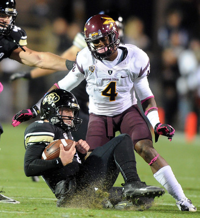 """CU QB, Jordan Webb slides in front of Alden Darby of ASU.<br /> For more photos of the game, go to  <a href=""""http://www.dailycamera.com"""">http://www.dailycamera.com</a><br /> Cliff Grassmick / October 11, 2012"""