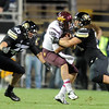 "Brady Daigh, left, and Jon Major of CU, close in on ASU QB, Taylor Kelly.<br /> For more photos of the game, go to  <a href=""http://www.dailycamera.com"">http://www.dailycamera.com</a><br /> Cliff Grassmick / October 11, 2012"