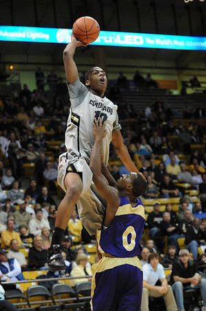 S1124CUBASKET2.jpg S1124CUBASKET2<br /> <br /> Cu's #10, Alec Burks flies over Alcorn defender #0, Kendrick McDonald during the men's basketball game between the Alcorn State Braves against the University of Colorado Buffaloes in the Coors Event Center on the University of Colorado Campus in Boulder Colorado on Tuesday November, 23, 2010. Final score: CU 91, Alcorn 51<br /> <br /> Photo by: Jonathan Castner