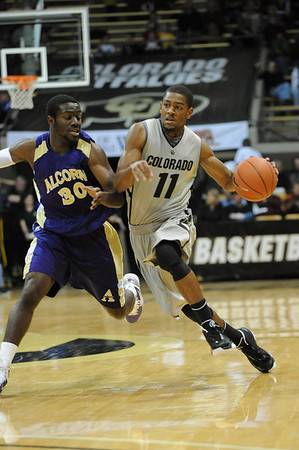 S1124CUBASKET4.jpg S1124CUBASKET4<br /> <br /> CU's #11, Cory Higgins runs to the key as Alcorn's 330, Tony Eackles defends during the men's basketball game between the Alcorn State Braves against the University of Colorado Buffaloes in the Coors Event Center on the University of Colorado Campus in Boulder Colorado on Tuesday November, 23, 2010. Final score: CU 91, Alcorn 51<br /> <br /> Photo by: Jonathan Castner