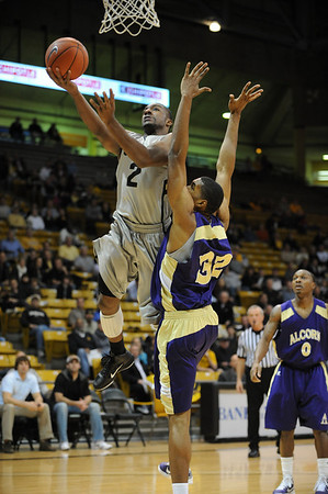 S1124CUBASKET1.jpg S1124CUBASKET1<br /> <br /> CU's #2, Shannon Sharpe puts one up and in against Alcorn's #32, Michael Starks during the men's basketball game between the Alcorn State Braves against the University of Colorado Buffaloes in the Coors Event Center on the University of Colorado Campus in Boulder Colorado on Tuesday November, 23, 2010.<br /> <br /> Photo by: Jonathan Castner