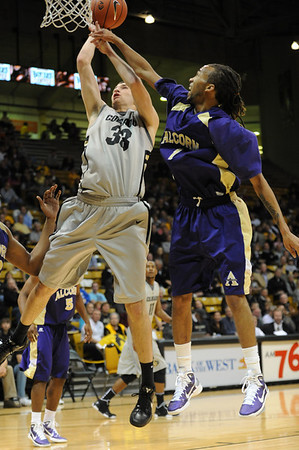 S1124CUBASKET3.jpg S1124CUBASKET3<br /> CU's #33, Austin Dufault is fouled under the basket by Alcorns' #1, Nate Thomlinson during the men's basketball game between the Alcorn State Braves against the University of Colorado Buffaloes in the Coors Event Center on the University of Colorado Campus in Boulder Colorado on Tuesday November, 23, 2010. Final score: CU 91, Alcorn 51<br /> <br /> Photo by: Jonathan Castner