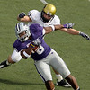 Kansas State running back Daniel Thomas (8) is chased by Colorado linebacker Jeff Smart (45) as Thomas runs for a short gain during the third quarter of an NCAA college football game Saturday, Oct. 24, 2009 in Manhattan, Kan. Kansas State won the game 20-6. (AP Photo/Charlie Riedel)