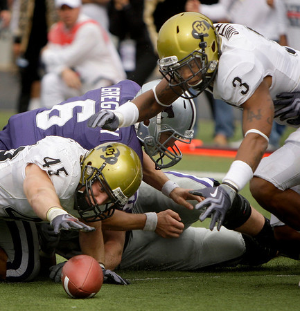 Colorado linebacker Jeff Smart (45) and cornerback Jimmy Smith (3) recover a ball fumble by Kansas State quarterback Grant Gregory (6) during the fourth quarter of an NCAA college football game Saturday, Oct. 24, 2009 in Manhattan, Kan. Kansas State won the game 20-6. (AP Photo/Charlie Riedel)