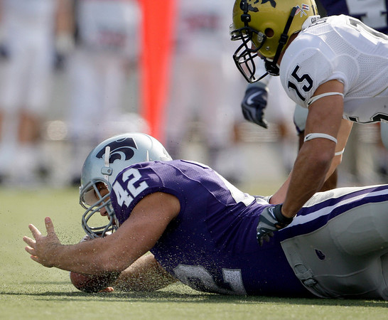 Kansas State safety Corey Adams (42) beats Colorado wide receiver Jason Espinoza (15) to recover a ball fumbled by Espinoza on a punt return during the second quarter of an NCAA college football game Saturday, Oct. 24, 2009 in Manhattan, Kan. (AP Photo/Charlie Riedel)