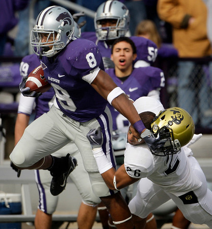 Kansas State running back Daniel Thomas (8) pulls off Colorado safety Ray Polk's helmet as he is pushed out-of-bounds during the first quarter of an NCAA college football game Saturday, Oct. 24, 2009 in Manhattan, Kan. (AP Photo/Charlie Riedel)