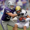 Kansas State linebacker John Houlik (39) tackles Colorado wide receiver Scotty McKnight (21) after McKnight caught a short pass during the fourth quarter of an NCAA college football game Saturday, Oct. 24, 2009 in Manhattan, Kan. Kansas State won the game 20-6. (AP Photo/Charlie Riedel)