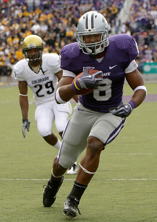 Kansas State running back Daniel Thomas (8) gets past Colorado cornerback Cha'pelle Brown (29) to score a touchdown during the second quarter of an NCAA college football game Saturday, Oct. 24, 2009 in Manhattan, Kan. (AP Photo/Charlie Riedel)