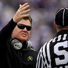 Colorado head coach Dan Hawkins, left, talks to an official during the fourth quarter of an NCAA college football game against Kansas State Saturday, Oct. 24, 2009 in Manhattan, Kan. Kansas State won the game 20-6. (AP Photo/Charlie Riedel)