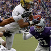 Colorado running back Rodney Stewart (5) dives past Kansas State linebacker Ulla Pomele, left, and defensive back Troy Butler (21) to score a touchdown during the first quarter of an NCAA college football game Saturday, Oct. 24, 2009 in Manhattan, Kan. (AP Photo/Charlie Riedel)