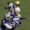 Kansas State defensive back Stephen Harrison (8) and defensive back Tysyn Hartmann (2) break up a pass intended for Colorado wide receiver Markques Simas (6) during the second quarter of an NCAA college football game Saturday, Oct. 24, 2009 in Manhattan, Kan. (AP Photo/Charlie Riedel)