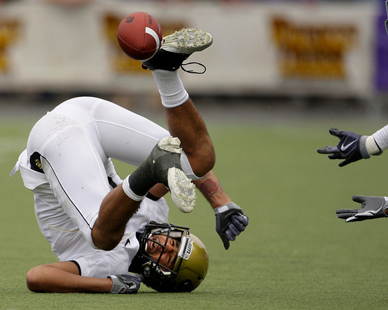 Colorado wide receiver Markques Simas tumbles on the ground after missing a pass broken up by Kansas State defensive back Joshua Moore, hands at right, during the fourth quarter of an NCAA college football game Saturday, Oct. 24, 2009 in Manhattan, Kan. Kansas State won the game 20-6. (AP Photo/Charlie Riedel)