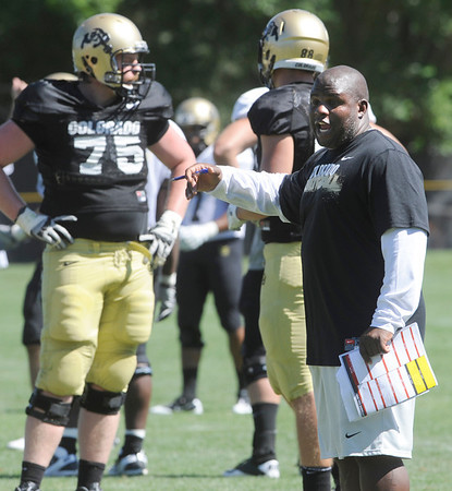 """Coach Eric Bieniemy isn't happy with the offensive performance during the University of Colorado football team practice on Monday.<br /> Photo by Paul Aiken  August 8, 2011.<br /> FOR MORE PHOTOS AND VIDEO INTERVIEWS FROM THE PRACTICE GO TO  <a href=""""http://WWW.DAILYCAMERA.COM"""">http://WWW.DAILYCAMERA.COM</a> OR BUFFZONE.COM"""