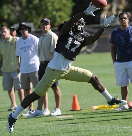 """Toney Clemons, 17, tries to pull in a pass during the University of Colorado football team practice on Monday.<br /> Photo by Paul Aiken  August 8, 2011.<br /> FOR MORE PHOTOS AND VIDEO INTERVIEWS FROM THE PRACTICE GO TO  <a href=""""http://WWW.DAILYCAMERA.COM"""">http://WWW.DAILYCAMERA.COM</a> OR BUFFZONE.COM"""
