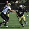 "Will Harlos, 28, defends in a passing drill against Austin Vincent, 81, during the University of Colorado football team practice on Monday.<br /> Photo by Paul Aiken  August 8, 2011.<br /> FOR MORE PHOTOS AND VIDEO INTERVIEWS FROM THE PRACTICE GO TO  <a href=""http://WWW.DAILYCAMERA.COM"">http://WWW.DAILYCAMERA.COM</a> OR BUFFZONE.COM"