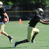 """Kennan Canty, 4, gets his hands on the ball during the University of Colorado football team practice on Monday.<br /> Photo by Paul Aiken  August 8, 2011.<br /> FOR MORE PHOTOS AND VIDEO INTERVIEWS FROM THE PRACTICE GO TO  <a href=""""http://WWW.DAILYCAMERA.COM"""">http://WWW.DAILYCAMERA.COM</a> OR BUFFZONE.COM"""
