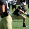 """Tyler McCulloch, 87, reaches low for the pass during the University of Colorado football team practice on Monday.<br /> Photo by Paul Aiken  August 8, 2011.<br /> FOR MORE PHOTOS AND VIDEO INTERVIEWS FROM THE PRACTICE GO TO  <a href=""""http://WWW.DAILYCAMERA.COM"""">http://WWW.DAILYCAMERA.COM</a> OR BUFFZONE.COM"""