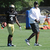 "Kennan Canty, 4, takes some pointers from Head Coach Jon Embree during the University of Colorado football team practice on Monday.<br /> Photo by Paul Aiken  August 8, 2011.<br /> FOR MORE PHOTOS AND VIDEO INTERVIEWS FROM THE PRACTICE GO TO  <a href=""http://WWW.DAILYCAMERA.COM"">http://WWW.DAILYCAMERA.COM</a> OR BUFFZONE.COM"