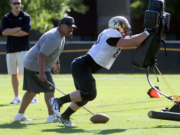 "Will Pericak, 83, works against a sled during the University of Colorado football team practice on Monday.<br /> Photo by Paul Aiken  August 8, 2011.<br /> FOR MORE PHOTOS AND VIDEO INTERVIEWS FROM THE PRACTICE GO TO  <a href=""http://WWW.DAILYCAMERA.COM"">http://WWW.DAILYCAMERA.COM</a> OR BUFFZONE.COM"