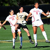 Kelly Menachof, center, of CU, battles with Kali Fournier, left, and Tiana Dickson of Oklahoma.<br /> Cliff Grassmick / October 2, 2009