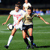 Jordan White of OU and Amanda Foulk of CU battle for the ball on Friday.<br /> Cliff Grassmick / October 2, 2009