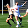 Kelly Ross, left, of CU, and Ashlee Coleman of OU, battle for control.<br /> Cliff Grassmick / October 2, 2009